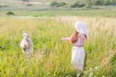 Russian girl with goat outdoor — Stock Photo