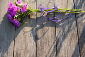 Flowers on wooden background — Photo