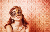 Beautiful Girl in a Carnival mask — Stock fotografie