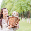 Girl with her dog resting outdoors — Stock Photo