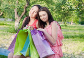 Two girls with colored bags outdoor — Stok fotoğraf