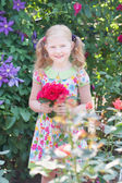 Irl with roses in garden — Stock Photo