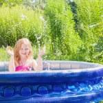 Girl in swimming pool — Stock Photo