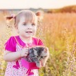 Royalty-Free Stock Photo: Little girl with cat outdoor