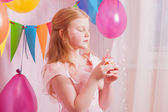 Girl in birthday party with cake — Stock Photo