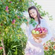 Beautiful girl with apple in garden — Stock Photo