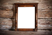 Old frame on wooden background — Stock Photo