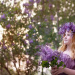 Beautiful girl with lilac flowers — Stock Photo