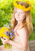 Girl with dandelions — Stock Photo