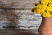 Dandelions on a wooden surface — Stock Photo
