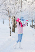 Happy beautiful girl in winter park — Stock Photo