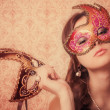 Beautiful girl in mask - Stock Photo