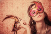 Beautiful girl in mask — Stockfoto