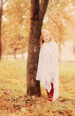 Sad girl in autumn park — Stock Photo