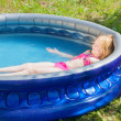 Girl in swimming pool — Stock Photo #26291825