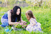 Mother with daughter in garden — Stock Photo