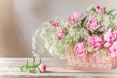 Pink peony in basket — Stock Photo