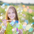 Beautiful girl with bubble soap outdoor — Zdjęcie stockowe