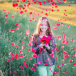 Portrait of a beautiful girl with red rose — Stock Photo