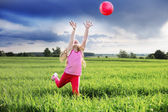 Little girl with ball outdoor — Stock Photo