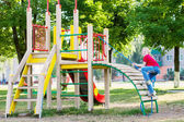 Girl on playground — Stock Photo