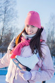 Beautiful brunette girl with ice skate outdoor — Stock Photo