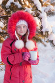 Girl with cup in winter forest — Stock Photo