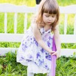 Little gardening girl with shovel — Stock Photo