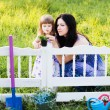 Mother with daughter in spring garden — Stock Photo