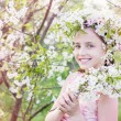 Stock Photo: Beautiful girl with spring flower