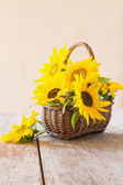 Sunflowers on wooden background — Stock Photo