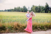 Mother and her daughter at the wheat field — Stock Photo
