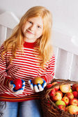 Girl with apples in basket — Stock Photo