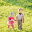 Children in beautiful spring green field — Stock Photo