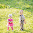 Stock Photo: Children in beautiful spring green field