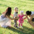 Two mothers with children in summer park — Stock Photo