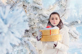 Beautiful girl in winter park — Stock Photo