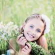 Stock Photo: Child girl at chamomile field