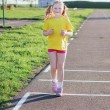 Stock Photo: Girl running on track