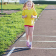 Girl running on track — Stock Photo #31746325