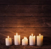 Candles on old wooden background — Fotografia Stock