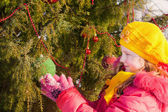 Beautiful girl with christmas tree in winter park — Stock Photo