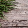 Branches from a Christmas-tree on wooden background — Stock Photo