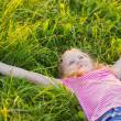 Girl on the meadow in summer day — Stock Photo