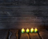 Candles on old wooden background — Stock Photo