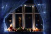 Christmas decoration on window — Stock Photo