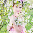 Beautiful girl with spring flower — Stock Photo