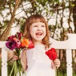 Stock Photo: Happy girl with tulips
