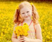 Happy girl with dandelion outdoor — Stock Photo