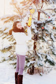Girl with christmas toy outdoor — Stock Photo